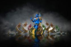 God Naga statue at khong river in the night
