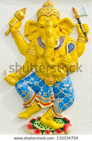 God of success 31 of 32 posture. Indian style or Hindu God Ganesha avatar image in stucco low relief technique with vivid color,Wat Samarn, Chachoengsao,Thailand.