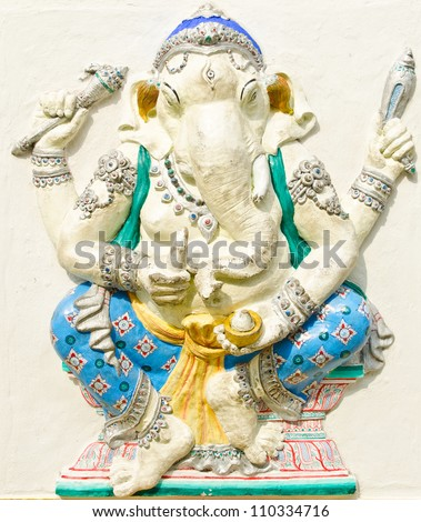 God of success 22 of 32 posture. Indian style or Hindu God Ganesha avatar image in stucco low relief technique with vivid color,Wat Samarn, Chachoengsao,Thailand.