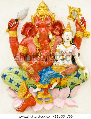 God of success 17 of 32 posture. Indian style or Hindu God Ganesha avatar image in stucco low relief technique with vivid color,Wat Samarn, Chachoengsao,Thailand.