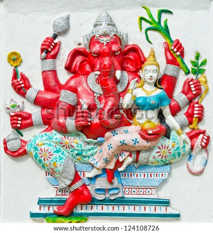 God of success 25 of 32 posture. Indian style or Hindu God Ganesha avatar image in stucco low relief technique with vivid color,Wat Samarn, Chachoengsao,Thailand.