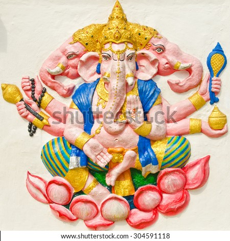 God of success 29 of 32 posture. Indian style or Hindu God Ganesha avatar image in stucco low relief technique with vivid color,Wat Samarn, Chachoengsao,Thailand.