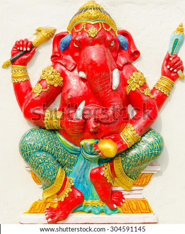 God of success 26 of 32 posture. Indian style or Hindu God Ganesha avatar image in stucco low relief technique with vivid color,Wat Samarn, Chachoengsao,Thailand.
