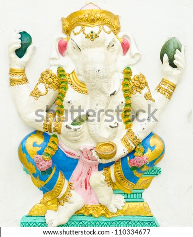 God of success 3 of 32 posture. Indian style or Hindu God Ganesha avatar image in stucco low relief technique with vivid color,Wat Samarn, Chachoengsao,Thailand.