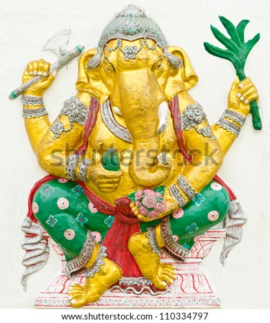 God of success 7 of 32 posture. Indian style or Hindu God Ganesha avatar image in stucco low relief technique with vivid color,Wat Samarn, Chachoengsao,Thailand.