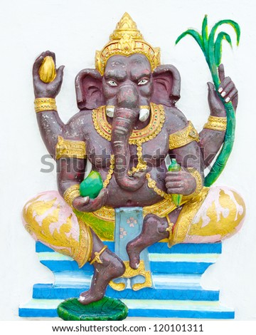 God of success 1 of 32 posture. Indian style or Hindu God Ganesha avatar image in stucco low relief technique with vivid color,Wat Samarn, Chachoengsao,Thailand.