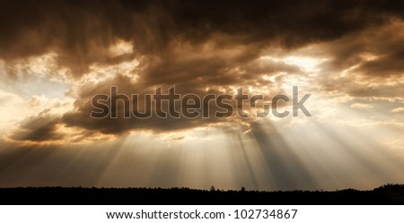 God's eye. Landscape cloudy sky, with rays of the sun.
