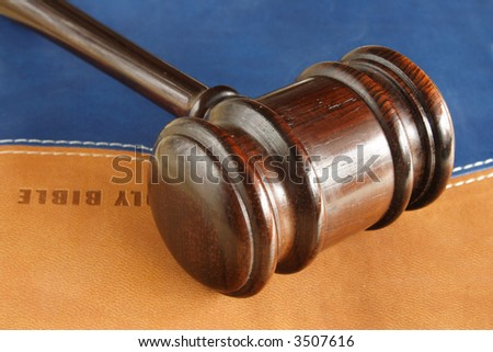 God's justice represented by bible and hammer