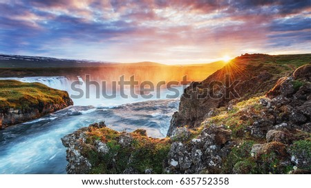 Godafoss waterfall at sunset. Fantastic landscape. Beautiful cumulus clouds. Iceland #635752358