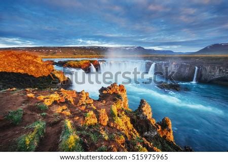 Godafoss waterfall at sunset. Fantastic landscape. Beautiful cumulus clouds. Iceland, Europe #515975965