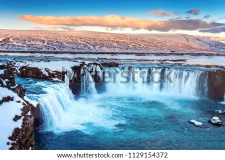 Godafoss waterfall at sunset in winter, Iceland. #1129154372