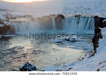 Godafoss waterfall during Winter at sunset. North Iceland - stock photo