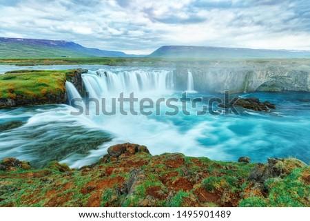 Godafoss waterfall, Iceland. Amazing long exposure scenery of famous landmark in Iceland - waterfall Godafoss. Popular tourist landmark, travel destination in Iceland. #1495901489