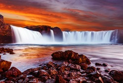 Godafoss waterfall with dramatic colorful sky during sunset, Icelandic nature scenery Amazing long exposure scenery of famous landmark in Iceland. Creative image best locations for photographers