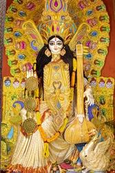 Goddess Saraswati idol decorated at Puja pandal, Saraswati symbolizes creative energy and is considered as the goddess of knowledge, music, art, wisdom, and learning.