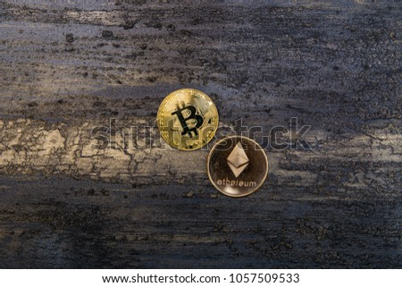 goden bitcoin and ethereum on dark bronze background #1057509533