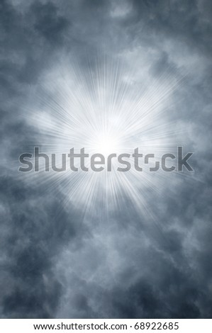 Godly rays shining through gray clouds