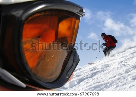 Goggle profile view with freeride scene as background