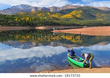 Going Fishing at scenic Crystal Reservoir in Pike National Forest, of Colorado, in Autumn with Pikes Peak soaring above