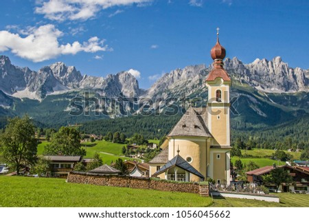 Going, idyllic village in Tyrol with the peaks of the Wilder Kaiser #1056045662