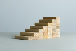 Going up concept using stairway of wood blocks