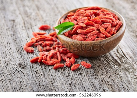 Goji berries on a wooden background #562246096