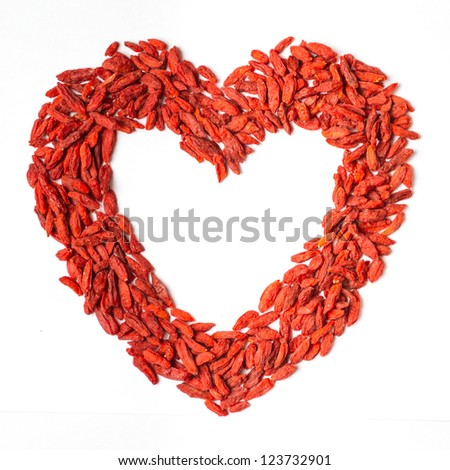 Goji berries with space in heart shape - stock photo