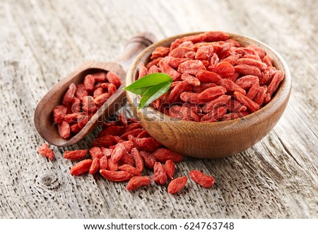 Goji berry on a wooden background #624763748