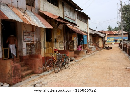 GOKARNA, INDIA - DEC 24: Bicycles near the hindus houses in old town at Christmas Eve on December 24, 2008 in Gokarna, India. Population of Gokarna is 26000. Gokarna in kannada means the cow's ear.