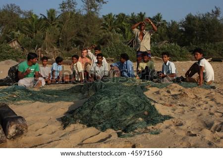 GOKARNA, INDIA - DECEMBER 16: Fishermen from Indian state Karnataka, prepare gear for fishing in the Indian ocean, December 16, 2008 in Gokarna, India. - stock photo