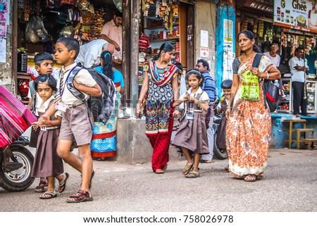 Gokarna Karnataka India 10-30-2017 Unknown people walking in main street of Gokarna in the morning   #758026978