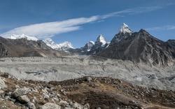 Gokyo glacier with mounts Everest, Nuptse, Lhotse, Nirekha, Kangchung, and Chola in background in the area of Cho Oyu - Gokyo region, Nepal, Himalayas