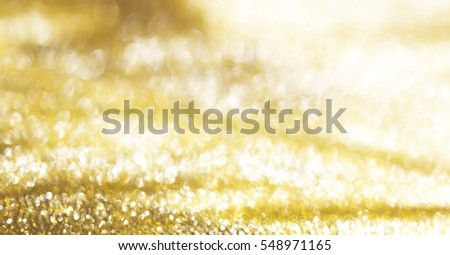 Gold abstract bokeh background paper glossy shine. #548971165