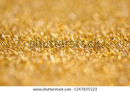gold abstract bokeh glitter texture background, filled with shiny gold glitter background.selective focus. #1247835523