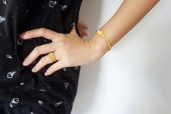 gold accessories or Gold jewelry such as necklaces, rings and bracelets on body of woman Which is beautiful when on a woman's body