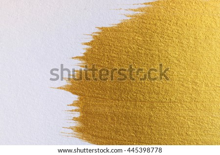 Gold acrylic paint on white paper background , gold texture free hand stoke object paint