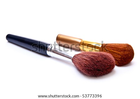Gold and black metal makeup brush isolated on white