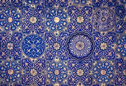 Gold and blue ceiling in a muslim mosque, islamic traditional religious ornament