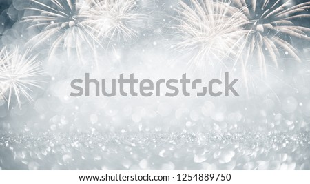 Gold and blue Fireworks and bokeh in New Year eve and copy space. Abstract background holiday. #1254889750