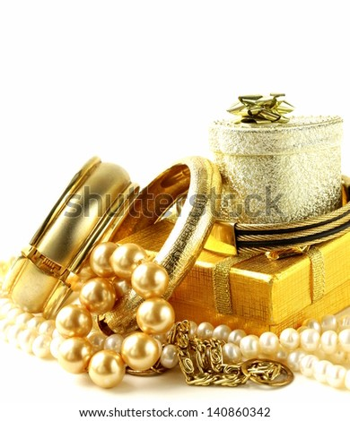 gold and pearl jewelry, gift boxes on a white background