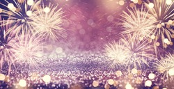 Gold and purple Fireworks and bokeh in New Year eve and copy space. Abstract background holiday.