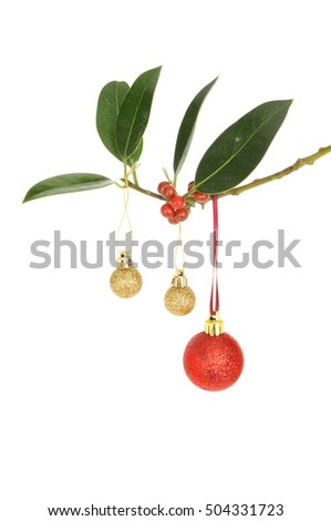 f6126041121e Gold and red glitter Christmas baubles hanging from a Holly branch isolated  against white #504331723