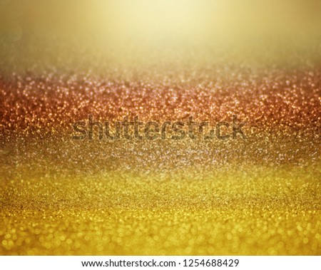 gold and rose gold abstract glitter background with soft glowing backdrop texture for christmas and valentine. #1254688429