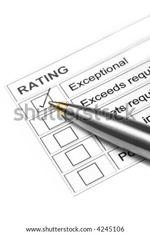 "Gold and silver ballpoint marking an ""exceptional""  rating."