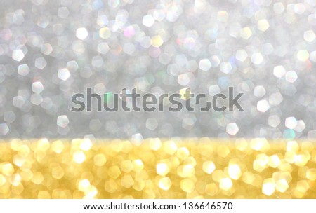 gold and silver defocused glitter lights background. abstract bokeh.