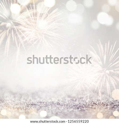 Gold and silver Fireworks and bokeh in New Year eve and copy space. Abstract background holiday. #1256559220