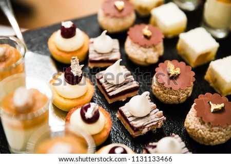 Gold and Silver Foiled Wedding Desserts and Mousses #1131133466