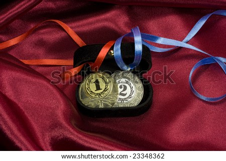 Gold and silver medals in the box