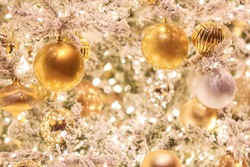 Gold and silver ornaments on a white Christmas tree at a Las Vegas casino. Elegant decoration perfectly suits the glamorous image of the city. 12/2019.