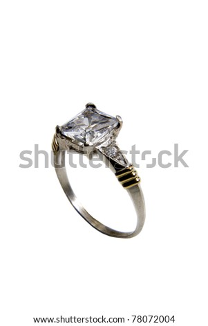 gold and silver ring with gemstone over white background